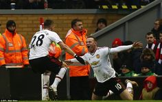 Rooney celebrates his goal against Liverpool with United team-mate Morgan Schneiderlin aft...