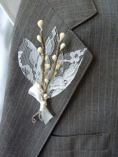 Do you want to make sure the whole bridal party is wearing lace? Create boutonnieres from lace and twigs (or flowers) for the groomsmen to wear.