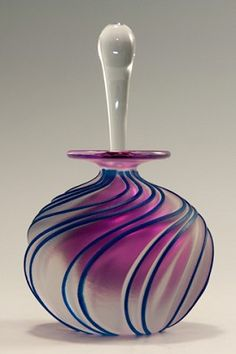 Lovely blown and carved, swirled perfume bottle by  Mary Angus...