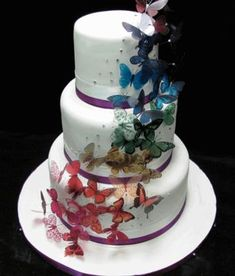 butterfly wedding cake but with pink and black butterflies