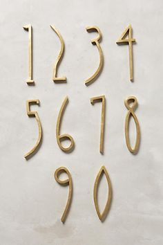 unique house numbers from anthropologie. vintage style gold house numbers