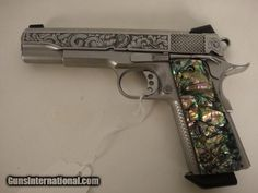 STAINLESS STEEL ENGRAVED BY BRIAN RICHELL ABALONE GRIPS