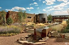 Architect Tim Blonkvist integrated the environmentally sensitive house he built for a Santa Fe couple right into the hillside site. Murase Associates designed the granite hardscape, including sculptural water features, and Design Workshop installed drough Jacuzzi, Landscape Architecture, Landscape Design, Desert Landscape, Garden Design, Brunswick House, Santa Fe Home, Nachhaltiges Design, Rustic Exterior