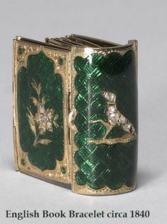 Book Bracelet (circa 1840) by an English jeweler. Made of Gold, Green Enamel, and Diamonds.