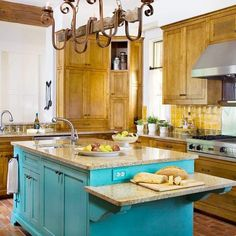 Spanish Colonial style kitchen design with a punch of turquoise on the eye-catching island