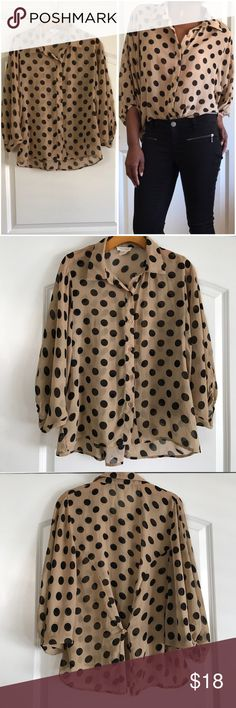 """Polka Dot Button Up Blouse Tan with black polka dots. Dolman sleeves and button cinch in the back. Flowing material that drapes over the body. Some slight fabric snag on right sleeve (pic included). In good condition. Length 22"""" front 26"""" in back, Sans Souci Tops Blouses"""