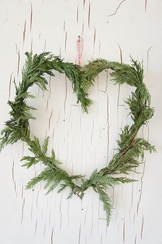an old door graced by an everygreen wreath, happy valentines day, now add little red berries,
