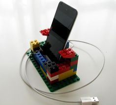 Why buy an iPod/Pad dock when you can build one... with LEGOS?? I did this and hot glued it! Best two hours of my life!!!