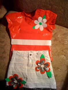 Duct tape shirt and skirt with duct tape flowers decorating them.