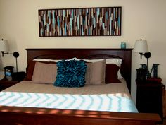 """You know that """"30 cheap art ideas for your wall"""" post that keeps getting reposted.  Well, I posted it too, but I also did one!!!  The art above my bed was inspired by the one made out of coffee stir sticks.  I used leftover cuts from a bed my husband built for our son. Cheap Art, Stir Sticks, Something To Do, Bedroom Ideas, Art Ideas, Husband, Lost, Inspired, Coffee"""