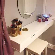 Dressing table using IKEA Ekby Alex shelving unit and mirror.