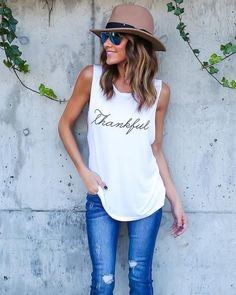 We are loving the message of this simple muscle tank! Layer this over other tanks or wear under your favorite cardigans and plaids. A perfect message for the festival Fall season. We are thankful for