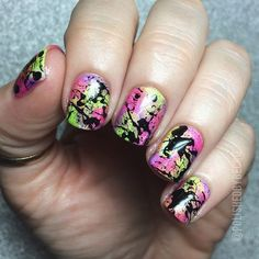 Loving the splashed paint effect on the nails? You can easily do this with help from water marble nail art effects.