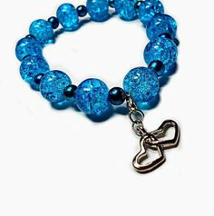 SALE Sapphire Crackled Design Translucent Beaded Stretch Bracelet w/Metallic Electric Blue Beads & Silver Dual Hearts Charm FREE SHIPPING - Only $6.29 on Etsy! https://www.etsy.com/listing/94785950/sale-sapphire-crackled-design