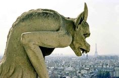 Must admire close up: Handsome gargoyle at Notre Dame (with Paris skyline in background) #architecture #travel