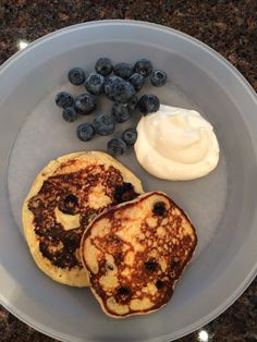 Not-your-typical blueberry pancakes! Add the following ingredients to a blender: 1 cup old fashioned oats (GF if necessary), 1 cup low fat cottage cheese (whipped or small curd, strained), 1 tsp vanilla, 2 eggs. Blend and carefully add 1 cup blueberries. Mix together (don't blend!) and add small spoonfuls on top of a hot skillet. Flip when bubbly and serve with maple-Greek yogurt (1 tbsp maple syrup mixed with 1/2 cup plain Greek yogurt). Enjoy!