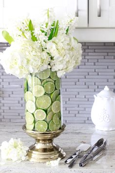 Learn how to create a fruit and floral arrangement in just a few easy steps! Also see what other gorgeous arrangements my friends are sharing!