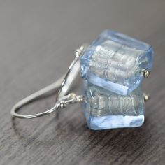 Light blue Murano glass earrings. The light blue Murano glass beads have a banding of 14K white gold lining inside which is one of the signature