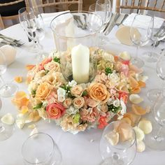 Peach and coral hurricane vase with candle, flower ring centrepiece. Miss piggy roses, peach avalanche roses, coral sweet peas. Nonsuch Mansion wedding. Pretty spring, laid back florals. Mixed spring flower bride bouquet. Anemones, ranunculas, narcissus. Surrey wedding flowers by Boutique Blooms floral design.