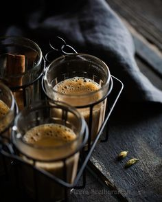 I never get tired of shooting Chai. I made a big pot of Masala Chai, first thing this morning to soothe my sore and itchy throat all day. The gorgeous moody light coming through one of our living room windows caught my attention when I sat there with my first cup of tea. I needed a very simple set up (check my Insta story) to get a few good clicks. I must tell you, these clicks really lighten and lift my spirits.  Btw, you'll be intrigued by the source of this prop. I found the set at the…