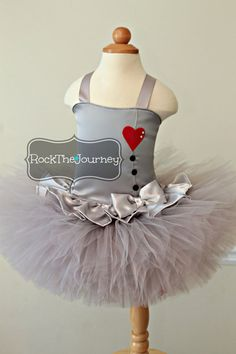 One of a kind Tin Man Girl 2-piece tutu and corset top thats sure to turn heads at any Wizard Of Oz, Yellow Brick Road, Story Book themed birthday party, Halloween Costume or event! **SHIPS 6 weeks from date of purchase**  **ALL ORDERS MUST INCLUDE A PARTY/EVENT DATE in the note to seller section. Date must not be before our turnaround time. Includes the TUTU & CORSET TOP ONLY (bloomers sold separately) Click here to add bloomers pictured…