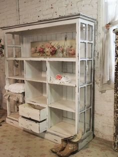 Handmade Bookcase - distressed paint finish on a bookcase made from salvaged wood and windows. Love!