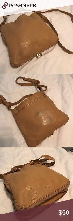 """Leather Fossil Cross-body Purse Light brown super soft leather, fossil purse in the style named """"Preston"""". Bottom unzips to make the bag larger. In great condition, the only flaw is that some color from clothing has rubbed onto the leather(see 2nd picture). I have not attempted to clean the bag. The strap is adjustable, and it has an outside zip pocket. 8.5"""" tall, 9.5"""" wide, 7"""" deep. Fossil Bags Crossbody Bags"""