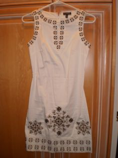 Available @ trendtrunk.com White Grecian Tunic Dress with Bronze Stud Detail. Dresses by Le Chateau. Only $40.00!