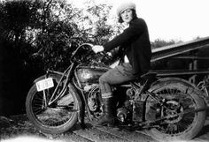 Vintage photo of a woman on her motorcycle.