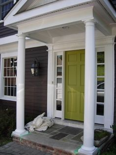 Everything I love dark grey house, white trim and granny smith apple GREEN door