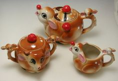 VINTAGE RUDOLPH THE RED NOSED REINDEER CERAMIC CHRISTMAS TEAPOT CREAM SUGAR SET. I have this!