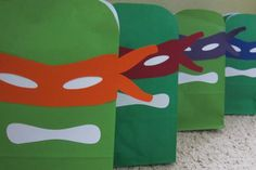 These are printable Teenage Mutant Ninja Turtle-inspired mask and mouth shapes in PDF format. They are made to fit standard paper (5.25 wide) gift