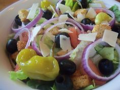 My whole family loves Olive Gardens Salad! There are already a couple of recipes here for the dressing, so here is a recipe for the salad itself.