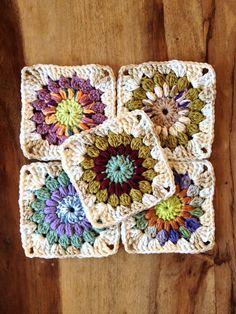 Ravelry: chitweed's Sunburst Granny Squares. Follow link to free pattern.