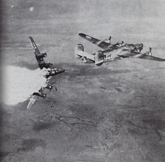 "Direct hit on B-24 A heavy US bomber B-24 ""Liberator"" took a direct hit of german flak and breaks apart."