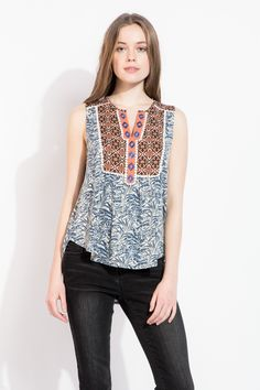 Love the mixed bohemian prints along with the embroidered center! Cute top to layer under a cardigan for winter and wear with shorts in spring!