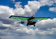 Come fly in a microlight! View wild game from the air and explore the bushveld from a unique perspective. Learn to fly. Part-time or full-time training possible. Pilot License, Kruger National Park, Adventure Activities, South Africa, Fighter Jets, Safari, Big 5, River, Explore
