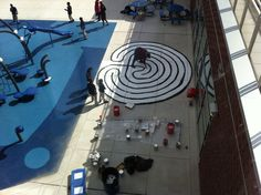 """Art teacher, Ms. Greta Schorn, led the third graders in the creation of a school labyrinth on the playground this month. Aided by a local artist, the children explored the rich history of labyrinths from ancient times to the present, planned their schoolyard addition in detail including a very large rough draft of the project on paper in the art studio, and then executed their design."""