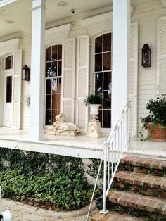 Exterior - I like the shutters that sit outside of the alcove for the front door and open out. I love the wood porch, brick steps and window trim. Interior Exterior, Exterior Design, Cafe Exterior, Exterior Shutters, Best Windows, Porch Windows, Ceiling Windows, Tall Windows, Porch Columns