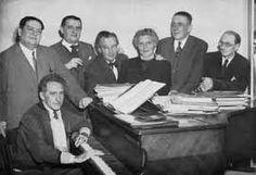 """Le groupe des six"" - (Jean Cocteau at the piano) : Darius Milhaud, Georges Auric, Arthur Honegger, Germaine Tailleferre, Francis Poulenc and Louis Durey. Famous Musicians, Famous Artists, Francis Poulenc, Piano, Leonard Bernstein, Jean Cocteau, Old Music, Conductors, Black And White Pictures"