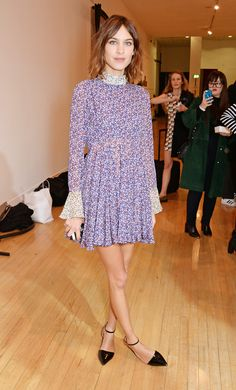 Alexa Chung at London Fashion Week in a micro-floral print high-collar dress with flared sleeves and black pointed ankle strap flats