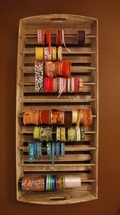 34 best diy ribbon gift wrap organizers storage ideas images on diy ribbon organizer yep you can convert an old wooden tray into a ribbon solutioingenieria Image collections