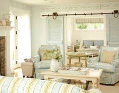And a pair of sofa chairs upholstered withNautical Fabric.    Coastal Summer Cottage Decor by Tracey Rapisardi