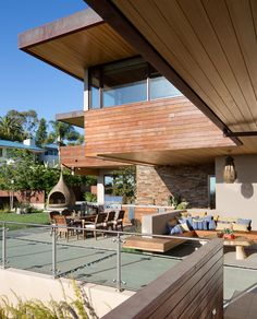 CHEN RESIDENCE   hillside home. large expansive deck. guest house and garage.  cantilevered roofs. photovoltaic cells and gray water collection. building materials include stone, copper, ipe wood siding and plaster.
