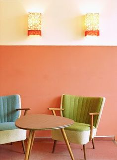 retro/vintage chairs and table. Atomic. Coral walls. Beautiful.