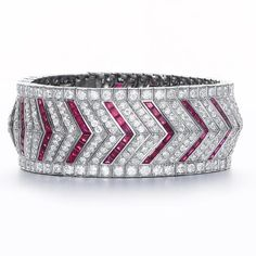 An art deco ruby and diamond bracelet, by Vever, circa 1925 The wide articulated band of old brilliant-cut diamonds alternating with calibré-cut ruby chevrons, all stones in millegrain settings, diamonds approximately 15.00 carats total, unsigned, French assay marks, inner diamter 5.5cm. (2) FOOTNOTES Accompanied by the original design drawing stamped Vever, 19 Rue de la Pont 19, Paris.