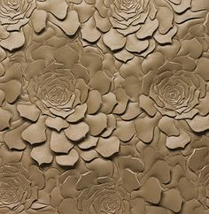 Le Temps Jadis:Helen Amy Murray | She stitches leather (or felt or fabric) on layers of fiberfill. Then the leather is cut near the stitches with a very sharp knife and the fiberfill pushes up the leather, creating a relief.