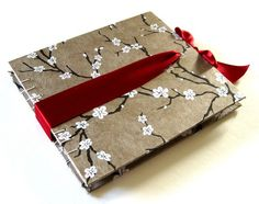 I chose this picture because the style is neat i love the designs plus the ribbon that holds the cover down , You could use the ribbon to hold materials.