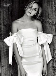 Bridget Malcolm wears off-the-shoulder wedding dress from Sachin & Babi Noir Bridal. Photo: Brides Magazine
