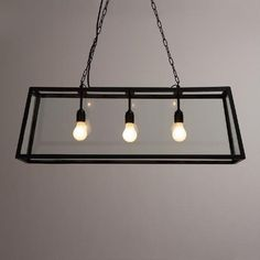 Crafted of clear glass panes set in a black iron frame, our exclusive pendant lamp is a dramatic, three-dimensional statement piece ideal for the dining room or any large space. >> Home Decor, Lighting Glass Pendant Light, Pendant Chandelier, Glass Pendants, Pendant Lighting, Dining Room Lighting, Home Lighting, Dining Rooms, Glass Ceiling Lights, Glass Lamps